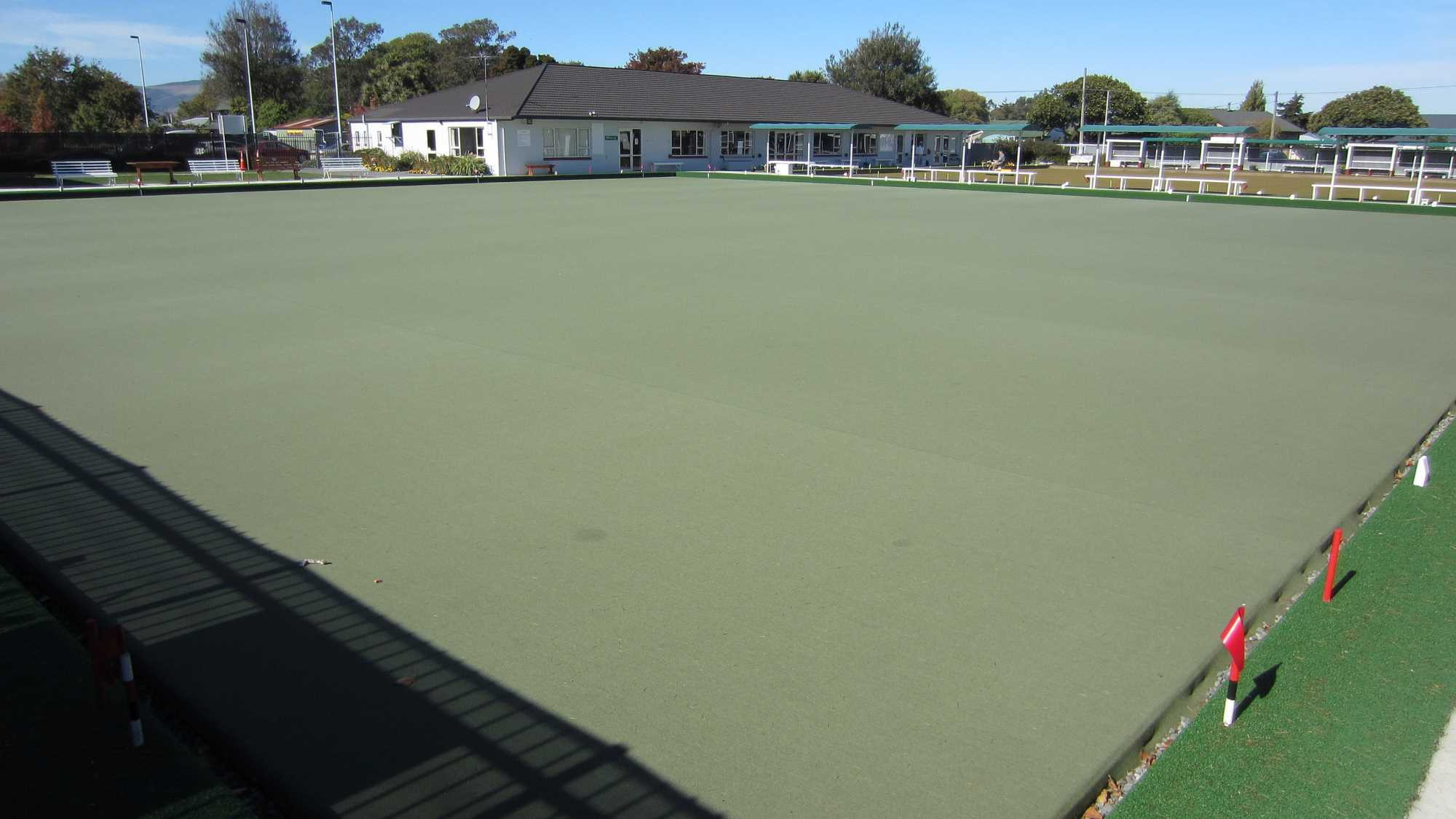 The All Weather Artificial Carpet with the Club House Behind