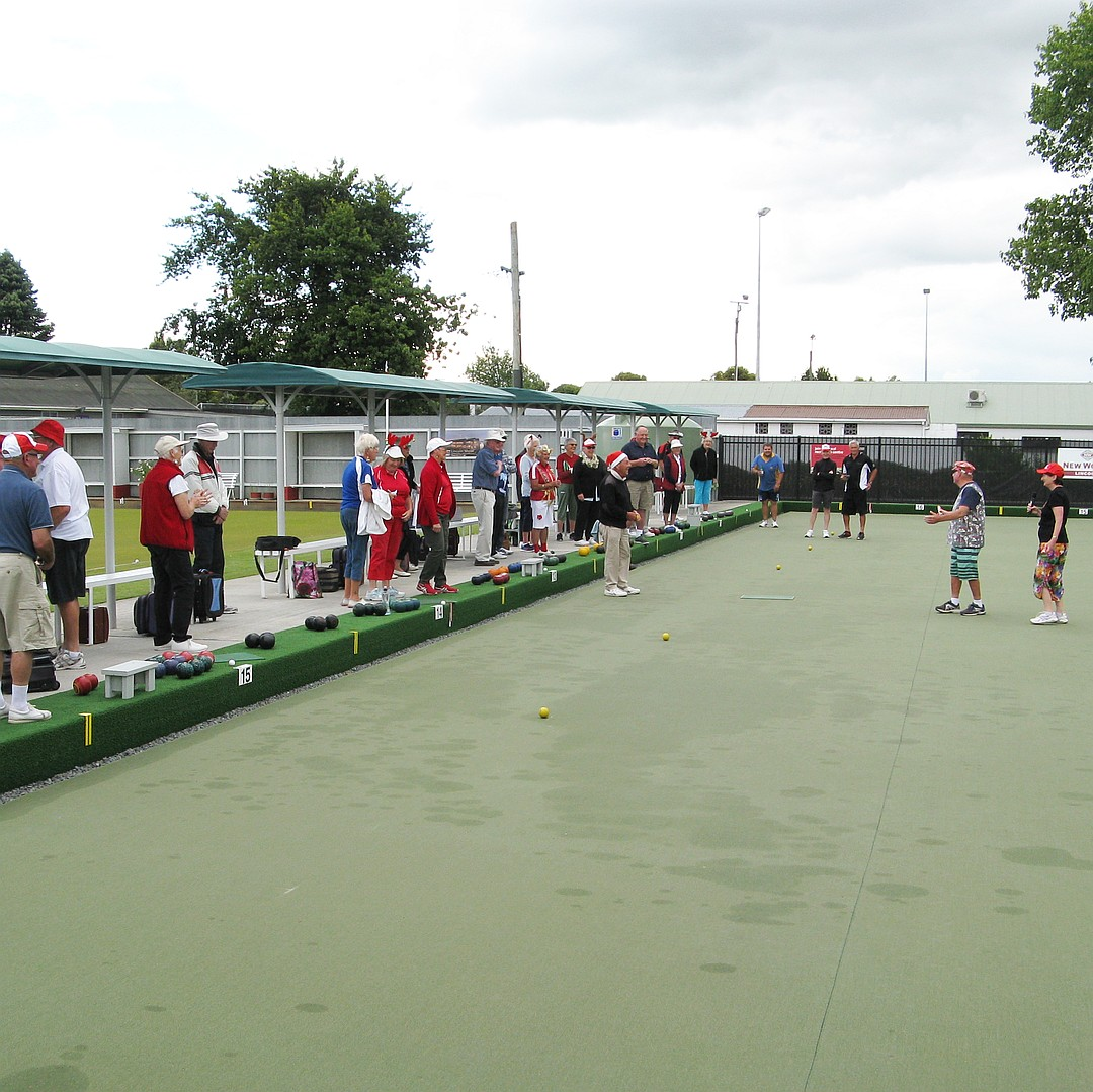 """Lois welcomes all to the Xmas Bowls and Mike wins the prize for """"Best Dressed""""."""